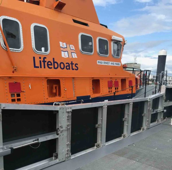 RNLI Weymouth picture of life boat and new fender wall featuring Bloxwich Door Gear BS2010N